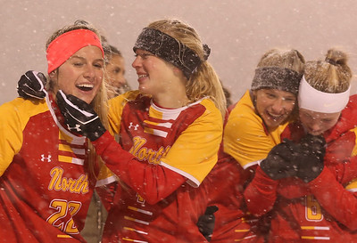 Jayden Sharpless (left), Grace Billmann and the North Catholic girls soccer team celebrate their win over Bedford. Seb Foltz/Butler Eagle 111720