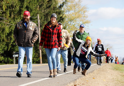 Trump rally attendees walk down Airport Road on their way to see President Donald Trump. Seb Foltz/Butler Eagle 11/01/20