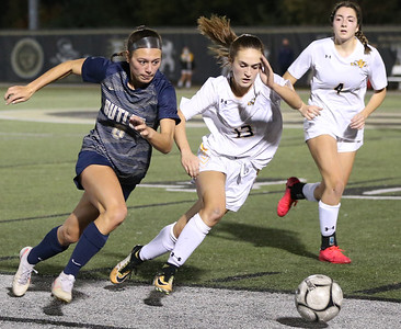 Butler's Chloe Weiland pushes past North Allegheny's Olivia Mark in Thursday's WPIAL Championship at Gateway. The Butler fell to the Tiger 2-1 in double overtime. Seb Foltz/Butler Eagle 11/05/20