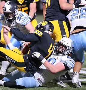 Seneca senior defensive end Josh Miller takes down North Allegheny quarterback Ryan Tresser for a sack in Friday's 21-7 playoff loss at NA. Seb Foltz/Butler Eagle 10/30/20