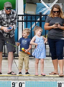 Irelayn Wood, 5, displays her displeasure with her father, Josh Wood, as he re-casts her fishing line. Irelayn was joined by her brother, Griffin 3, and aunt Kelly Christie of Butler as well as her mother, Cassie Wood and siblings Jaymin, 11, Emmalyn,9.  Harold Aughton/Butler Eagle
