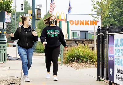 Slippery Rock University senior Lesa Bressanelli and sophomore Ryleigh King walk down Main St. in Slippery Rock Thursday. Seb Foltz/Butler Eagle 09/17/20