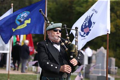 Bag piper George Balderose plays in Glade Run Cemetary following Saturday's Veterans' Memorial dedication. Seb Foltz/Butler Eagle 09/26/20