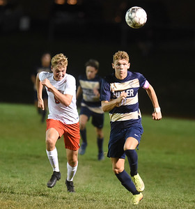 Landon Mohney tracks down the ball in the first period against North Hills. Harold Aughton/Butler Eagle.