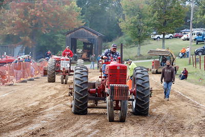 Dennis Musser competes in the vintage tractor pull at the Portersville Steam Show Saturday. Seb Foltz/Butler Eagle 10/03/20