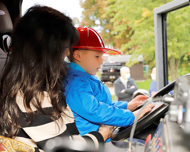 Greyson Worth, 3, of butler hits trys the horn on one of Butler Township's fire engines with his grandmother Karen Jahn, part of the township's National Night Out event on Holland Drive Tuesday evening. Seb Foltz/Butler Eagle 10/06/20