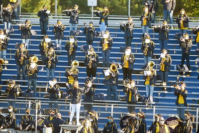 Harold Aughton/Butler Eagle: The Butler High School marching band social distance by commandeering the visitors stand Friday, September 18, 2020.