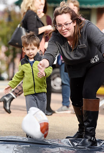 Crichton Bly,4, received a little help from his mother, Audrianna Bly, during the Butler Rotary's turkey bowl fundraiser to raise money to eradicate polio in Diamond Park, Wednesday, October 21, 2020.. Harold Aughton/Butler Eagle.