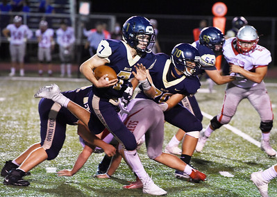 Butler's Cooper Baxter looks for running room in the first half against Slippery Rock. Harold Augthon/Butler Eagle.