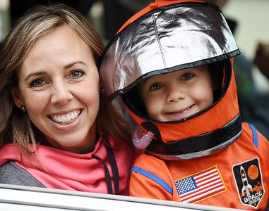 Jenna Hurbanek and her son, Grayson, 4, drove through the line at the Mars Elementary School drive through trick or treat. Harold Aughton/Butler Eagle
