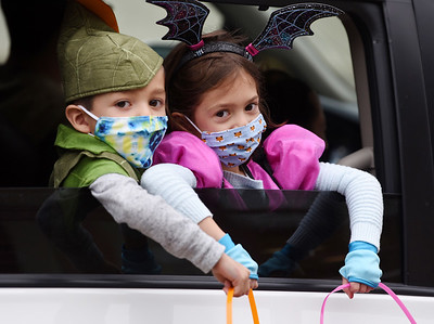 Isacc Simon,4, and his sister Hadley Simon,6, collected candy during the trick or treat drive through at the Mars Elementary School. Harold Aughton/Butler Eagle.