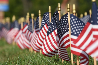 Harold Aughton/Butler Eagle:Volunteers from Mars placed 2,977 flags representing those who died in 911 in front of the Mars High School Thursday, September 10, 2020.