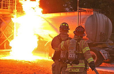 Cranberry Fire Department Lt. Connor Mack (right) and John Murtha practice putting out a simulated truck fire at the Butler County Community College fire training center during a training class Wednesday. Seb Foltz/Butler Eagle 09/17/20