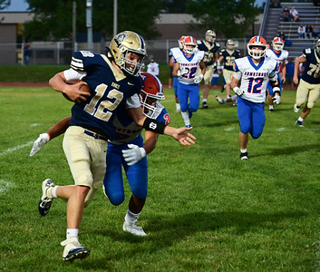 Knoch #12 J.J. Szebalskie runs a quarterback keeper during a game verses Armstrong at Knoch Stadium on Friday September 25, 2020 (Jason Swanson photo)