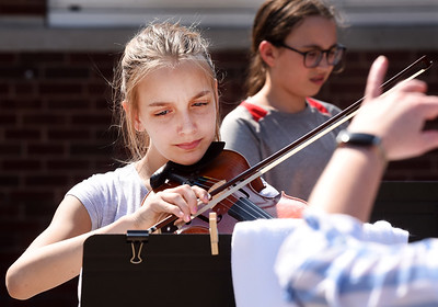 Rebekah Hall, a sixth grader at Penn Christian Academy, plays her violin during the middle school band & orchestra practice outside the school Thursday, April 8, 2021. Harold Aughton/Butler Eagle.
