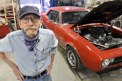 Steve Povlick, owner of Nick's Body Shop in Lyndora, is retiring after working over 50 years in the auto body industry. He plans to continue working on his own cars like the 1967, 468 Big Block, Chevrolet Camaro in the background, and driving them around the country. Harold Aughton/Butler Eagle.
