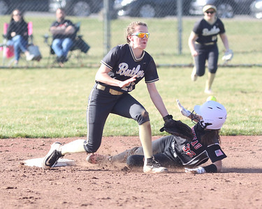 Moniteau's Mariska Shunk beats a throw to Butler shortstop Lauren Hesidenz on a steal. Seb Foltz/Butler Eagle 03/30/21