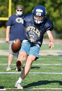 Harold Aughton/Butler Eagle: Sophmore kicker Alex Titus practices Tuesday morning under the direction of kicking coach Stephen Vanlaningham.