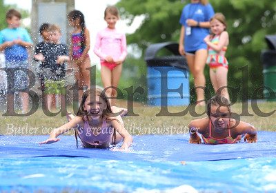 Camp Cranberry day campers cool off with a slip-n-slide session Friday afternoon at Cranberry Township Community Park. Seb Foltz/Butler Eagle 07/31/20
