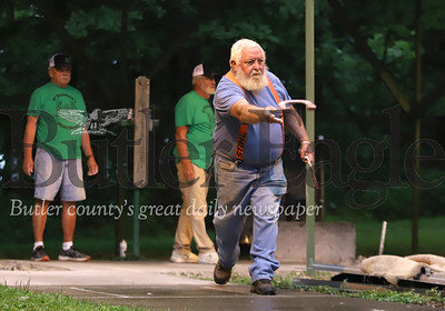 Ron Hans of Herman throws a horseshoe for the Dew Drop Inn team in a league game against O'Donnell's Distributor Tuesday evening at the Dew Drop Inn. Seb Foltz/Butler Eagle