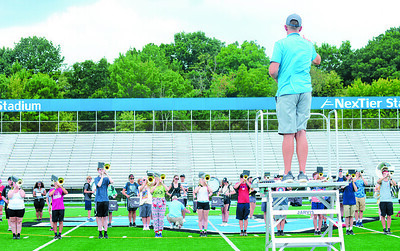 Varden Armstrong, director at Seneca Valley, directs the marching band at band camp practice. Photo: Julia Maruca / Butler Eagle