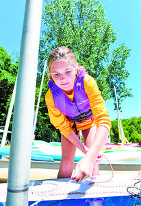 Ashlynn Wees, 12, prepares to launch her sail boat during the Moraine Sailing Club's Youth Sail Camp Tuesday.  Nearly 50 campers attended the one-week camp. Harold Aughton/Butler Eagle