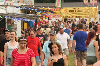 Saxonburg area residents and visitors enjoyed a summer night at the Saxonburg Fair Tuesday following the town's Pet Parade. Seb Foltz/Butler Eagle