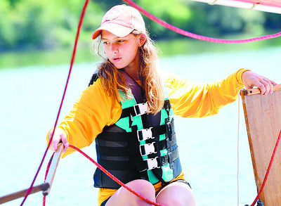 Lillianna Vogle,14, launches her sail boat during the Moraine Sailing Club's Youth Sail Camp Tuesday.  Nearly 50 campers attended the one-week camp. Harold Aughton/Butler Eagle