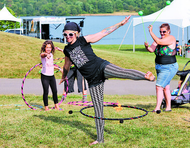 Penni Laine of Sirkus Dayz hoola hoops with fire at the Moraine State Park Regatta Friday. Seb Foltz/Butler Eagle 08/06/21