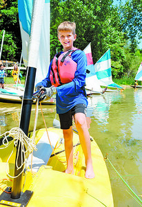 Jacob Gray, 11, of Grove City prepares to launch his sail boat during the Moraine Sailing Club's Youth Sail Camp Tuesday.  Nearly 50 campers attended the one-week camp. Harold Aughton/Butler Eagle