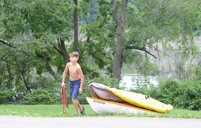 Calum Shaltes, 9, helps pack up his canoe after exploring Glade Run Lake with his family. Julia Maruca / Butler Eagle