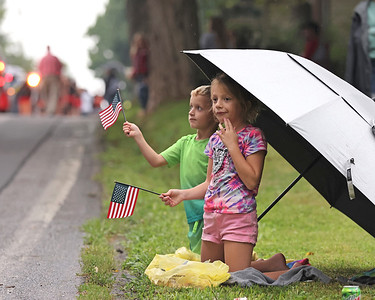 Lyndal McFadden, 7, and Lawson McFadden, 5, wave to parade participants at the North Washington Rodeo Parade Monday. The rodeo competition opens Tuesday and runs through Saturday, Aug 21. Seb Foltz/Butler Eagle 08/16/21