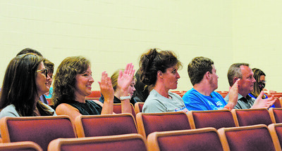 Parents applaud comments speaking against the idea of a mask mandate at a Mars Area School District meeting on Tuesday night. Photo: Julia Maruca