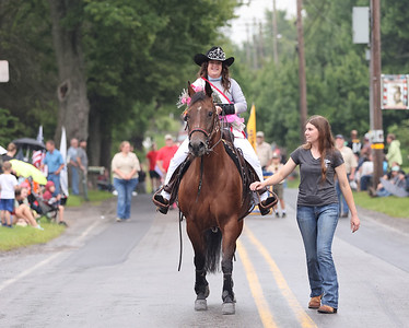 North Washington Rodeo Queen Paige Kennedy, 19, of Meridian leads her horse past the North Washington Fire Department during Monday's rodeo kickoff parade. The rodeo competition opens Tuesday and runs through Saturday, Aug 21. Seb Foltz/Butler Eagle 08/16/21