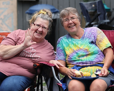 Karen Olexsak of North Washington and her cousin Becky Christie of Salem, Mass., set up shop with a pre-parade talegate at Olexsak's  house along the North Washington Rodeo Parade Route Monday. The rodeo competition opens Tuesday and runs through Saturday, Aug 21. Seb Foltz/Butler Eagle 08/16/21