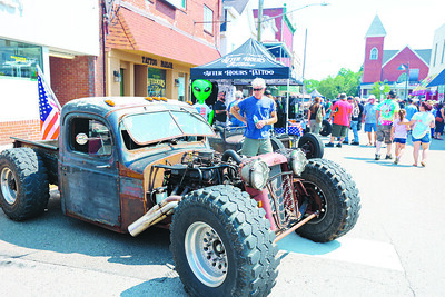 A 'ratrod' hotrod sits on Main Street next to Mars Rumble  car show organizers After Hours Tatoo shop. Seb Foltz/Butler Eagle 07/31/21