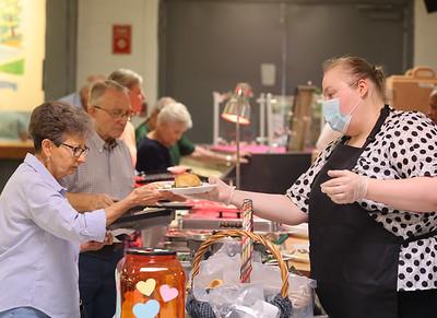 Christine Robitalle serves Sandra Rapp at Tanglewood Wednesday. Seb Foltz/Butler Eagle 08/04/21
