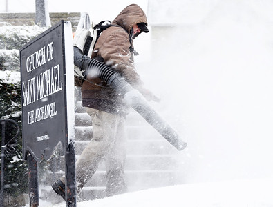 Will Frisco blows the ice and snow off the sidewalks at St. Michaels the Archangel Parish along Center Ave. in Butler Tuesday, December 1, 2020. Harold Aughton/Butler Eagle