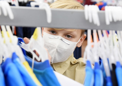 Boy Scout Elijah Adley, 12, of Cabot shops for gifts during Troop 58's annual shopping spree for families in need Tuesday, December 9, 2020. Harold Aughton/Butler Eagle.