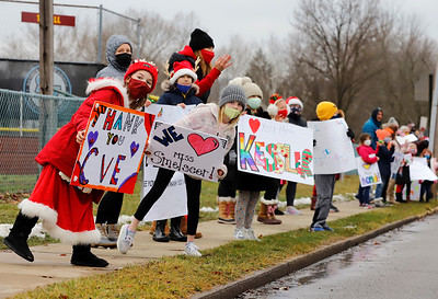 Emily Thompson (left), Andi Voelp, along with other students  and parents from Connoquenessing Valley Elementary line Beaver St. in Zelienople to show appreciation for their teachers Tuesday. Seb Foltz/Butler Eagle 12/22/20