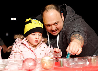 Miranda Johnson, 4, and Ray LaMarca of Harrisville work on Johnson's glitter ornament at Ginger Hill Tavern's Christmas ornament and letters to Santa station during Slippery Rock's Christmas Market Saturday. Seb Foltz/Butler Eagle 11/21/20