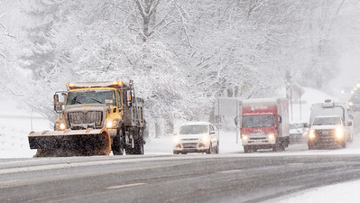 A PennDot plow truck leads the way as drivers adapted to the road conditions along route 8 near the intersection of Airport road in Butler Twp. Tuesday morning, December 1, 2020. Harold Aughton/Butler Eagle.