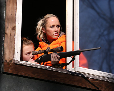 Maddie Osborn,11, and her mother Amber look out from the family's tree-house-style hunting blind Saturday on their property near Grove City. Seb Foltz/Butler Eagle 11/28/20