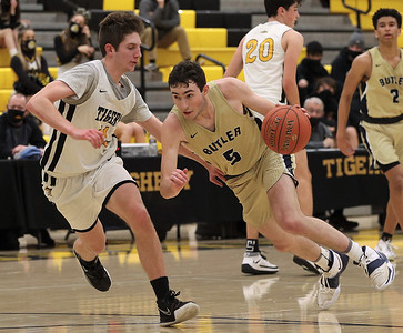 Butler's Mattix Clement drives down court against North Allegheny's Matt McDonough in Butler's 81-74 loss at NA. Seb Foltz/Butler Eagle 02/10/21