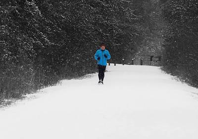 Heidi Fleming of Butler runs along the Butler Freeport Trail Tuesday. Seb Foltz/Butler Eagle  (Color edited) 02/09/21