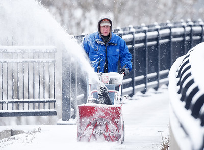 Kevin Hodgens of Butler clears snow from the General Richard Butler Bridge along Route 8 as part of a program through the AARP. The City of Butler Parks Department is acting as the host agency. Harold Aughton/Butler Eagle.