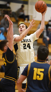 Knoch's C. Green attempts a shot in the second period. Harold Aughton/Butler Eagle.