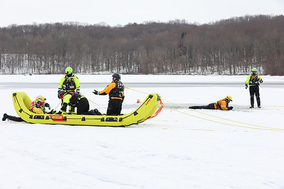 Members of Butler County Water Rescue Team 300 and area firefighters practice ice rescues Saturday on Moraine State Park's Lake Arthur. Seb Foltz/Butler Eagle  02/13/21