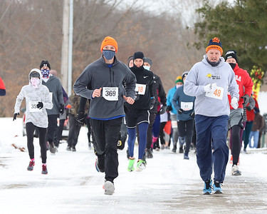 Runners brave cold temperatures and slick roads Saturday at Lake Arthur Golf Club for the annual Cupid's Chase 5K. The nationwide race benefits Community Options, a nonprofit for adults with intellectual disabilities. Seb Foltz/Butler Eagle 02/13/21