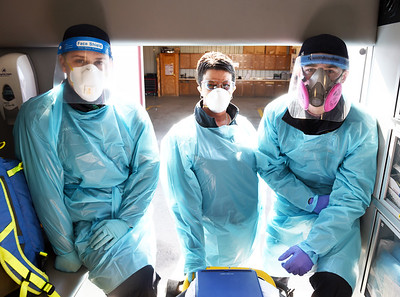 (From left) EMT Eric Hacker, Heather Flack, EMT crew chief; and driver Lucas Hentschel, EMT in training of Quality EMS Ambulance Services wear full PPE depending on the call Thursday, February, 25, 2021. Harold Aughton/Butler Eagle.